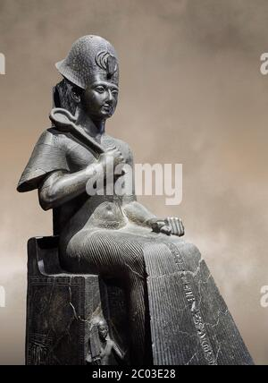 Ancient Egyptian statue of Ramesses II. granodiorite, New Kingdom, 19th Dynasty, (1279-1213 BC), Karnak, Temple of Amon. Egyptian Museum, Turin. Grey - Stock Photo