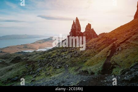 One of the most photographed wonders in the world. The Old Man of Storr during sunset in Isle of Skye, Highlands in Scotland, United Kingdom. - Stock Photo