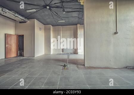 construction site of residential apartment renovation. empty room before reimbursement new concrete interior - Stock Photo