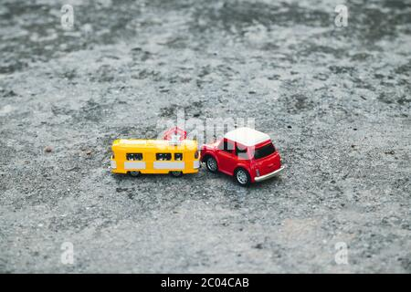 Podolsk,Odessa / Ukraine - June 11 2020: Miniature toy model cars crash accident scene transport and accident concept on concrete asphalt road background - Stock Photo