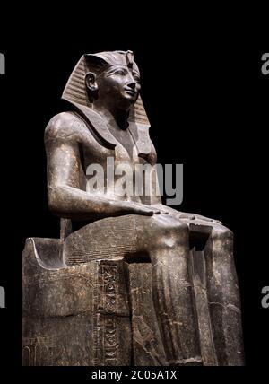 Ancient Egyptian statue of Tuthmosis II, granodorite, New Kingdom, 18th Dynasty, (1479-1425 BC), Karnak, Temple of Amun. Egyptian Museum, Turin. black - Stock Photo