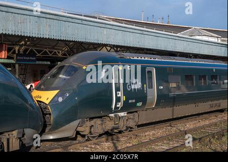 Azuma passenger trains in GWR livery waiting at Bristol Temple Meads railway station, England. - Stock Photo