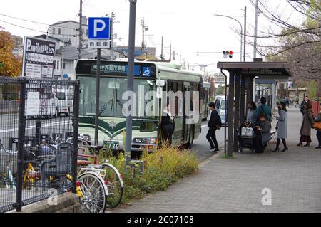 Kyoto, Japan - Dec 7, 2018: Bus station in Kyoto near Kamo River - Stock Photo