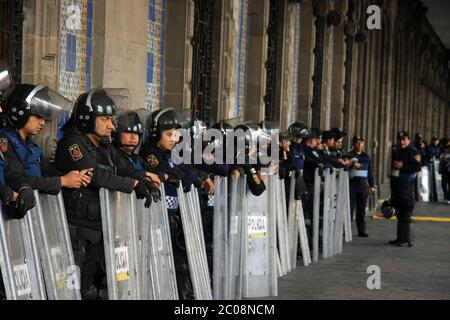 Mexican Police Officers in Riot Gear outside building in Zocalo Square, Mexico City Stock Photo