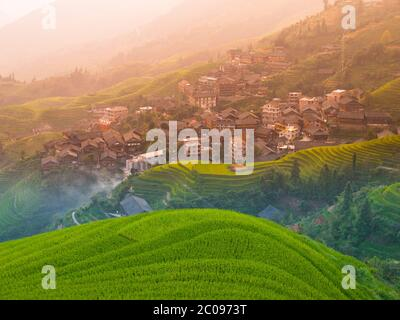 Traditional chinese village wooden houses in the middle of rice terraces, Pingan, Guangxi, China - Stock Photo