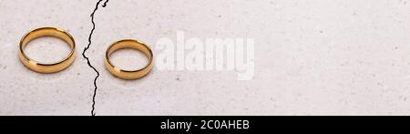 Separated Broken Wedding And Engagement Rings. Couple Divorce - Stock Photo