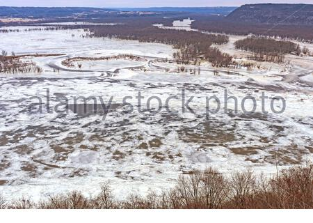 Frozen Confluence of the Wisconsin and Mississippi Rivers in Winter at Pikes Peak State Park in Iowa - Stock Photo