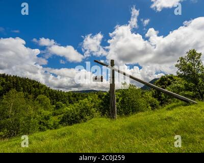 Interesting artistic work hanging small model house atop hill near lake Mrzla vodica Croatia Europe - Stock Photo