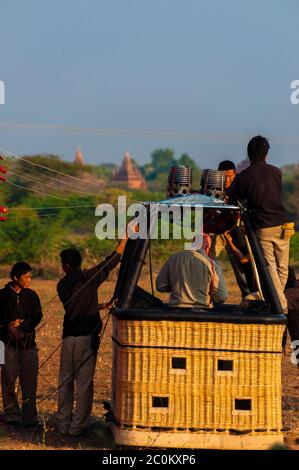 Hot air balloon crew working in basket