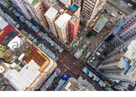 Sham Shui Po, Hong Kong 19 March 2019: Top view of Hong Kong city, street market - Stock Photo