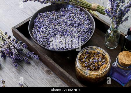 Lavender flowers and natural cosmetics in wooden tray - Stock Photo
