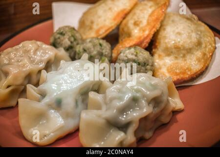 Typical Korean cooked and fried soup dumplings with meat - Stock Photo