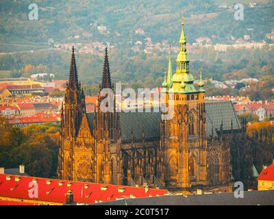 St Vitus Cathedral - landmark of Prague Castle historical complex. Aerial view from Petrin Hill Lookout Tower in the evening sunset time. Prague capital city of Czech Republic, Europe. UNESCO World Heritage Site - Stock Photo