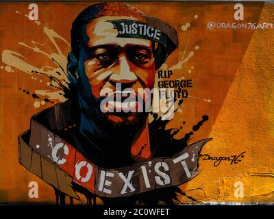 New York, New York, USA. 12th June, 2020. New York, New York, U.S.: street artist Dragon76 painted a mural in honor of George Floyd in East Village during the peaceful protests opposing systemic racism and police brutality. Credit: Corine Sciboz/ZUMA Wire/Alamy Live News - Stock Photo