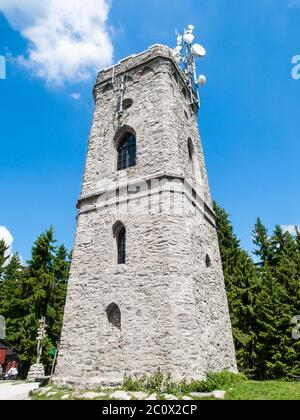 Old stone lookout tower Zaly in Giant Mountains, Krkonose, Czech Republic. - Stock Photo