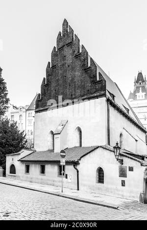 Old New Synagogue in Jewish Quarter Josefov in Prague, Czech Republic. Black and white image.