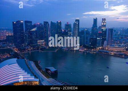 Aerial night view of the skyline of Singapore's downtown viewed from Marina Bay Sands Hotel's terrace. Singapore - Stock Photo
