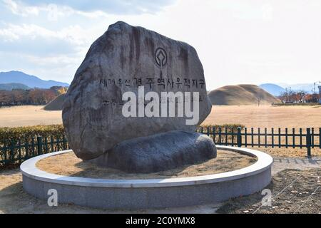 Stone UNESCO signboard in front of the Daerungwon Royal Tombs Complex in Gyeongju South Korea - Stock Photo