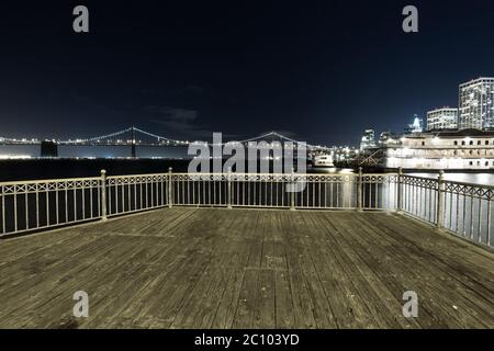 empty floor with suspension over water in san francisco at night - Stock Photo