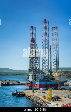 Offshore oil drilling platforms anchored in Cromarty Firth near Invergordon, Scotland, United Kingdom, Europe. - Stock Photo