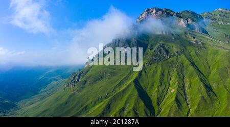 Spring landscape of mountains and meadows near the Portillo de Lunada in the Valle del Miera, Cantabria, Spain, Europe