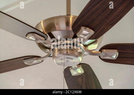 Standard ceiling fan with built in lights five blade design and metal downrod - Stock Photo