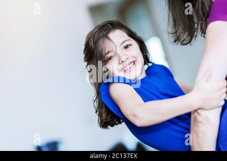 complicity between a very cute little girl and her mother