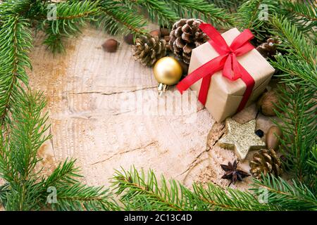 Christmas frame decorated with gift box und fir branches. - Stock Photo