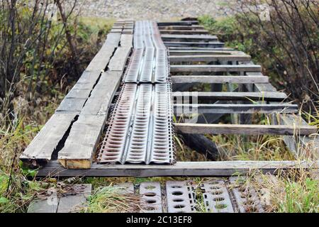 destroyed a bridge across the ditch from wooden planks and metal profiles.
