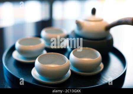 elegant chinese tea set on plate - Stock Photo
