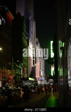 Night life neon light lively crowd ad in New York City - Stock Photo