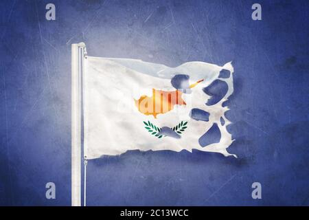Torn flag of Cyprus flying against grunge background - Stock Photo