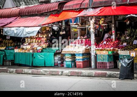 Chiang Mai Thailand - July 2017. On the side of the road a vendor selling a wide variety of fruit and vegitables from market stall. - Stock Photo