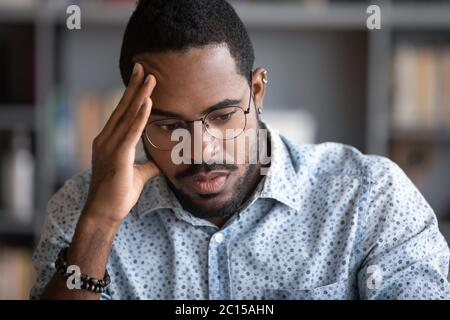 African businessman thinking of problem solution feels concerned