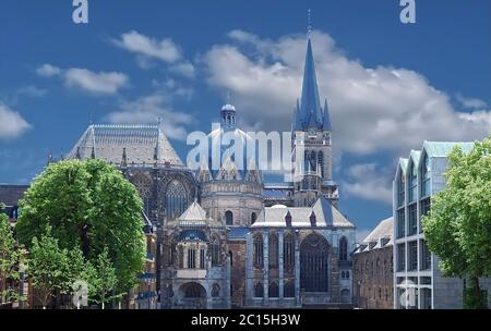 Famous cathedral or dome of Aachen in Germany with blue sky - Stock Photo