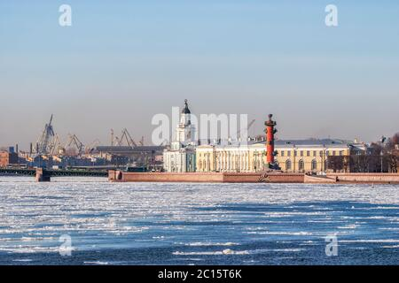 View of the Spit of Vasilyevsky Island in St. Petersburg on a bright March day during an ice drift on the Neva River. - Stock Photo