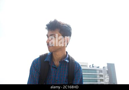 side view of young teen student on a backpacks .corporate company background.