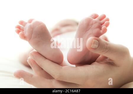 the mother's hand holds legs