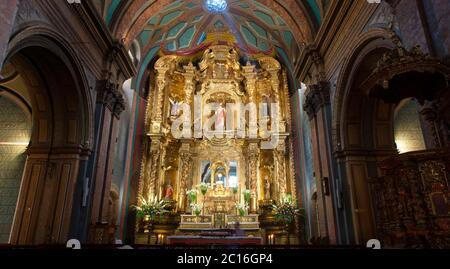 Quito, Pichincha / Ecuador - November 1 2019: Front view of the main altar of the church of El Sagrario in the historic center of Quito - Stock Photo
