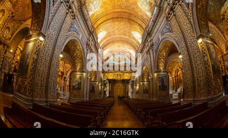 Quito, Pichincha / Ecuador - November 1 2019: Group of tourists inside of the Church of the Society of Jesus, known colloquially as la Compania, is a - Stock Photo