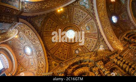 Quito, Pichincha / Ecuador - November 1 2019: View from below of the dome of the Church of the Society of Jesus, known colloquially as la Compania, is - Stock Photo
