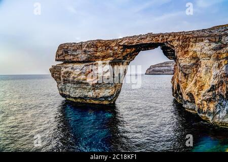 Sea view to Azure window natural arch, Gozo island Malta - Stock Photo