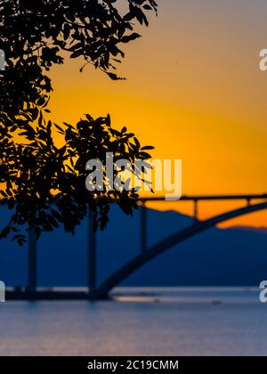 Sunset dusk landscape bridge mainland to island Krk Croatia - Stock Photo