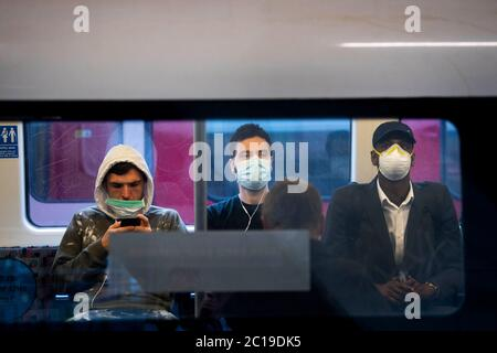 Passengers wearing face masks on the Jubilee Line in East London as face coverings become compulsory on public transport in England with the easing of further lockdown restrictions during the coronavirus pandemic. - Stock Photo