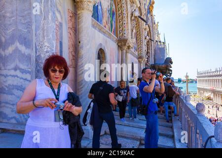 Tourists enjoying the view from the St Mark`s Basilica balcony, Metropolitan city of Venice,Italy,June 7th 2016 - Stock Photo