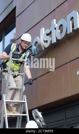 Bristol, UK. 15th June, 2019. The sign for the Colston Hall is removed today. Edward Colston has been a contentious figure in Bristol's history, in 2018 the board of the Colston Hall decided Colston was a toxic brand and decided to change the name of this prestigious venue. The Black Lives Matter protest where the statue of Colston was thrown in the harbour has energised the removal of his name from the hall. Credit: Mr Standfast/Alamy Live News - Stock Photo