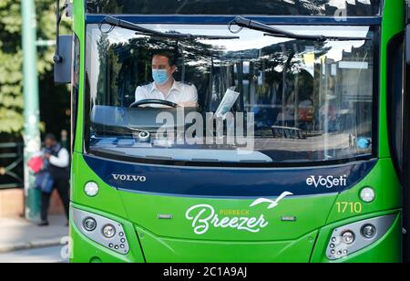 Bournemouth, UK. 15th June 2020.  Bus drivers in Bournemouth wearing masks at the wheel on the day public transport users have to wear compulsory face coverings when travelling.Credit: Richard Crease/Alamy Live News - Stock Photo