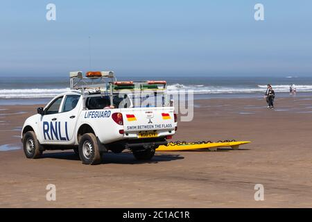 The RNLI patrolling the beach at Whitby, England.