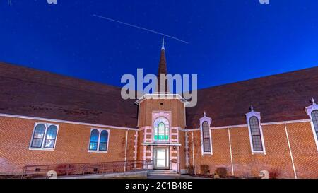 Panorama Front view of a beautiful brick church in Provo Utah with deep blue sky overhead