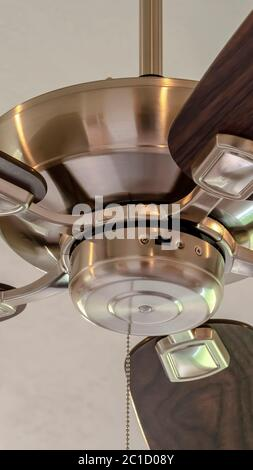 Vertical Standard ceiling fan with built in lights five blade design and metal downrod - Stock Photo
